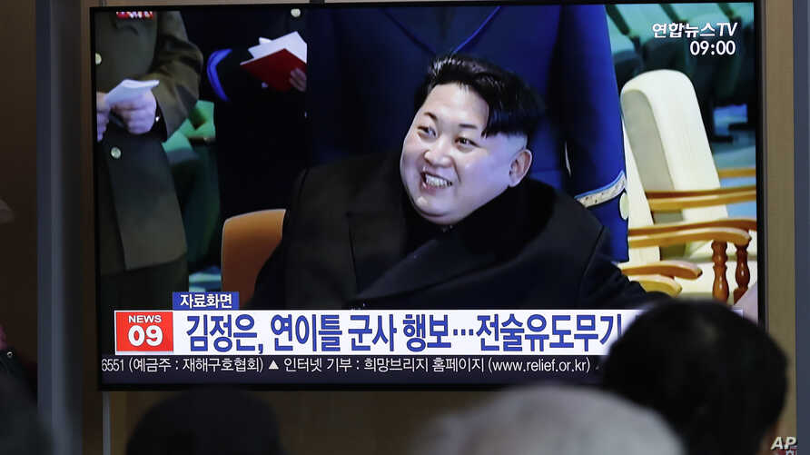 "People watch a TV news program reporting about North Korea's test-fire of a ""new-type tactical guided weapon,"" with a file footage of North Korean leader Kim Jong Un, at the Seoul Railway Station in Seoul, South Korea, Thursday, April 18, 2019…"