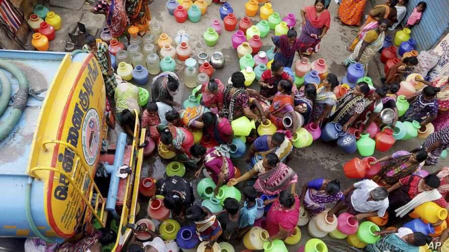 Indians stand in queues to fill vessels filled with drinking water from a water tanker in Chennai, capital of the southern Indian state of Tamil Nadu, June 19, 2019.
