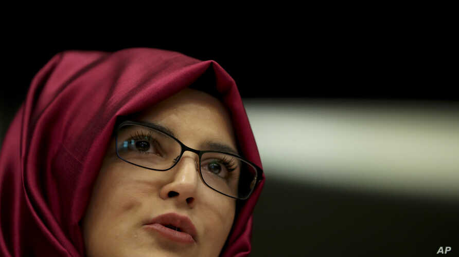 FILE - Hatice Cengiz, the fiancee of slain Saudi journalist Jamal Khashoggi, gives a statement during a hearing about human rights situation in the Arab Peninsula at the European Parliament in Brussels, Tuesday, Feb. 19, 2019.
