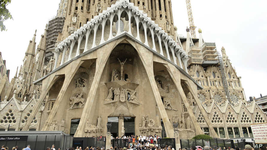 FILE - Dignitaries leave after a Mass at Barcelona's Sagrada Familia Basilica for the victims of the terror attacks, in Barcelona, Spain, Aug. 20, 2017.  Barcelona's town hall announced June 7, 2019, it had granted the church a work permit through 2026.