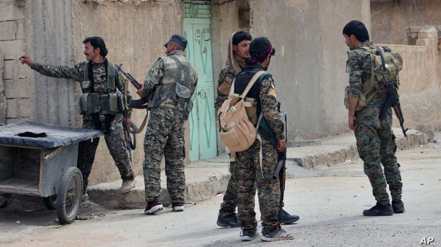 FILE -- This Sunday, April 30, 2017, file photo, provided by the Syrian Democratic Forces (SDF), shows fighters from the SDF patrolling in the northern town of Tabqa, Syria. U.S.-backed Syrian forces say the battle for control of the Islamic State…
