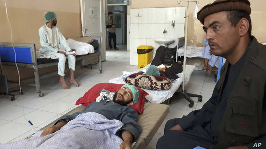 Wounded men receive treatment in a hospital after a Taliban attack in the Nahrin district of Baghlan province north of Kabul, Afghanistan, Saturday, June 29, 2019.  Afghan officials say the Taliban insurgent attack late Friday against pro-government…