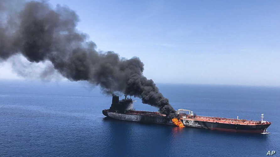 An oil tanker is on fire in the sea of Oman, June 13, 2019. Two oil tankers near the Strait of Hormuz were reportedly attacked Thursday, an assault that left one ablaze and adrift as sailors were evacuated from both vessels and the U.S. Navy rushed to assist amid heightened tensions between Washington and Tehran. (AP Photo/ISNA)