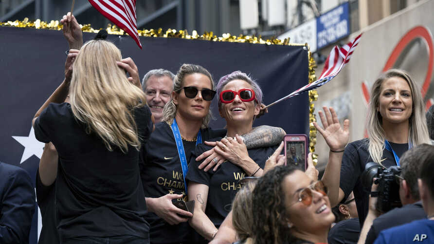 Members of the U.S. women's soccer team, including Megan Rapinoe, center and Julie Ertz, at right waving, celebrates during a ticker tape parade along the Canyon of Heroes, Wednesday, July 10, 2019, in New York. The U.S. national team beat the…