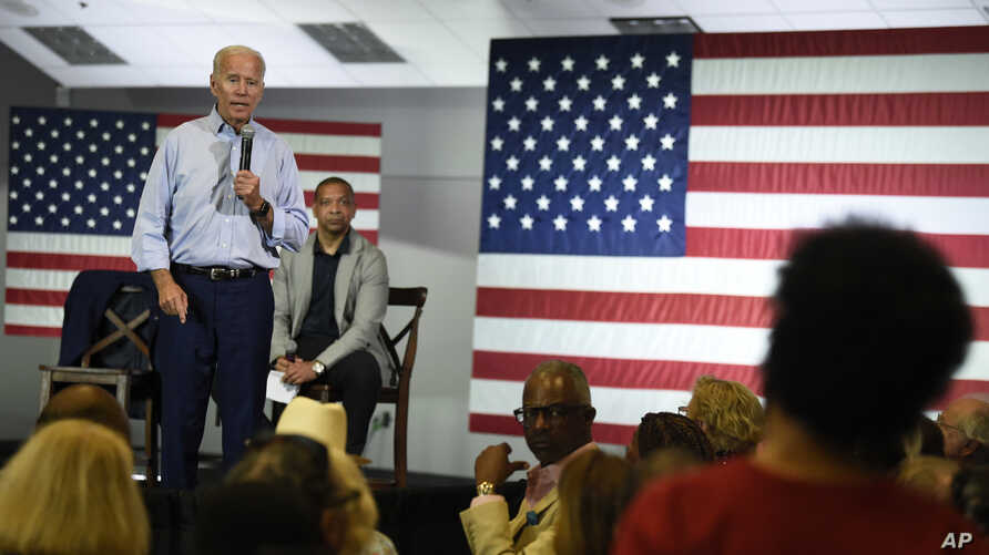 Democratic presidential candidate and former Vice President Joe Biden answers a question from Crystal Gadsden White about the importance he places on unions during a town hall on Sunday, July 7, 2019, in Charleston, S.C., as state Sen. Marlon…