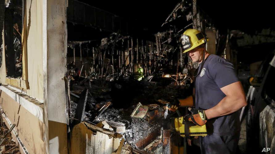 A fireman looks over a home Saturday, July 6, 2019 that burned after a earthquake in Ridgecrest, Calif. The Friday evening quake with a magnitude of about 7.1 jolted much of California, cracking buildings, setting fires, breaking roads and causing…