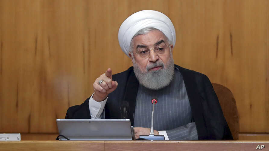 In this photo released by the office of the Iranian Presidency, President Hassan Rouhani speaks in a cabinet meeting in Tehran, Iran, Wednesday, July 3, 2019. Rouhani warned European partners in its faltering nuclear deal on Wednesday that Tehran…