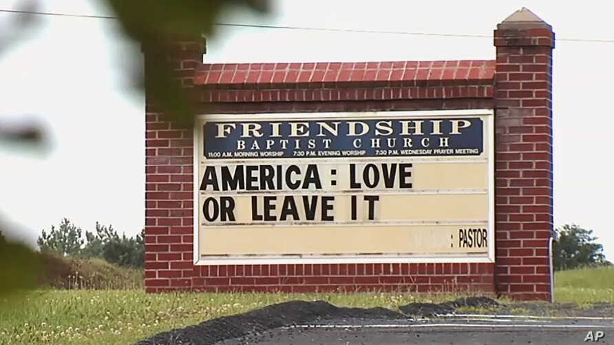 "FILE - This Tuesday, July 16, 2019 image from video provided by WSET-TV shows a sign for the Friendship Baptist Church which reads, ""America: Love it or Leave It"" in Appomattox, Va. Amid a national furor over President Donald Trump's tweet urging…"