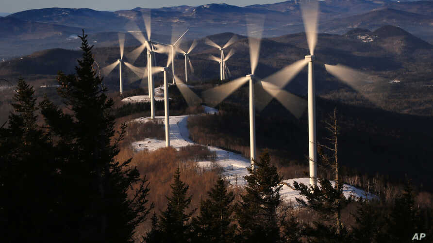 The blades of wind turbines catch the breeze at the Saddleback Ridge wind farm in Carthage, Maine, March 19, 2019.