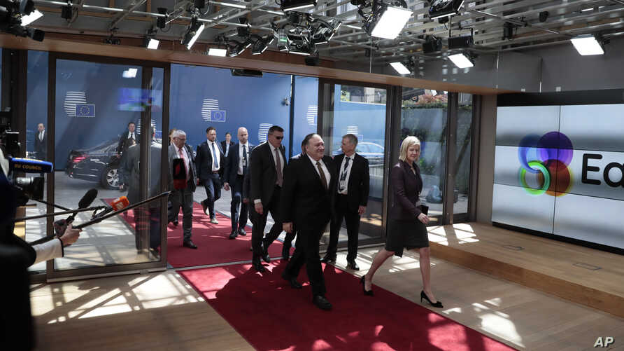 U.S. Secretary of State Mike Pompeo, center, arrives for a meeting of the US and the E3 at the Europa building, Monday, May 13, 2019.