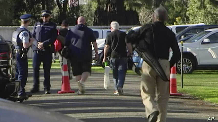 In this image made from video, people bring their guns to exchange for money in Christchurch, New Zealand Saturday, July 13, 2019. Dozens of Christchurch gun owners on Saturday handed over their weapons in exchange for money, in the first of more…