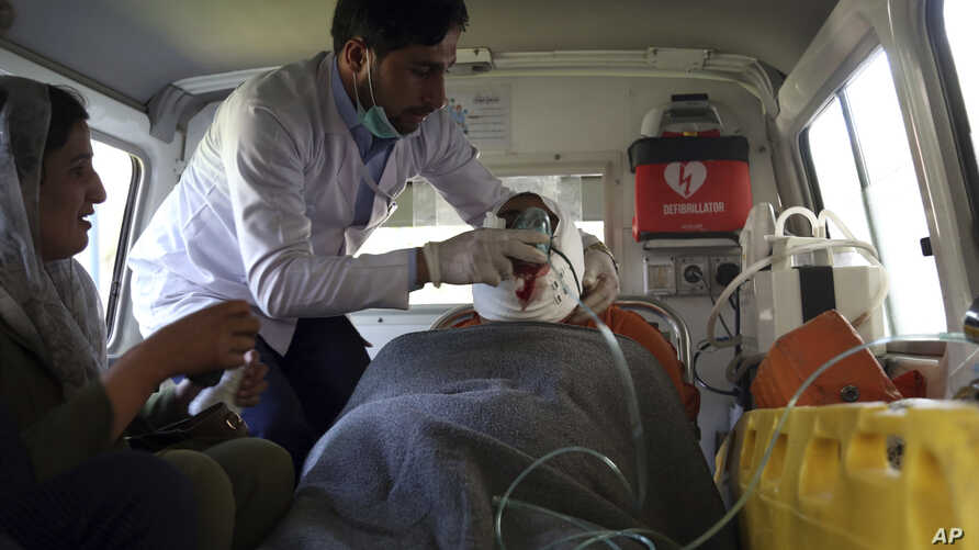 A doctor treats an injured man in an ambulance after a powerful bomb blast in Kabul, Afghanistan, Monday, July 1, 2019. A powerful bomb blast rocked the Afghan capital early Monday, rattling windows, sending smoke billowing from Kabul's downtown…