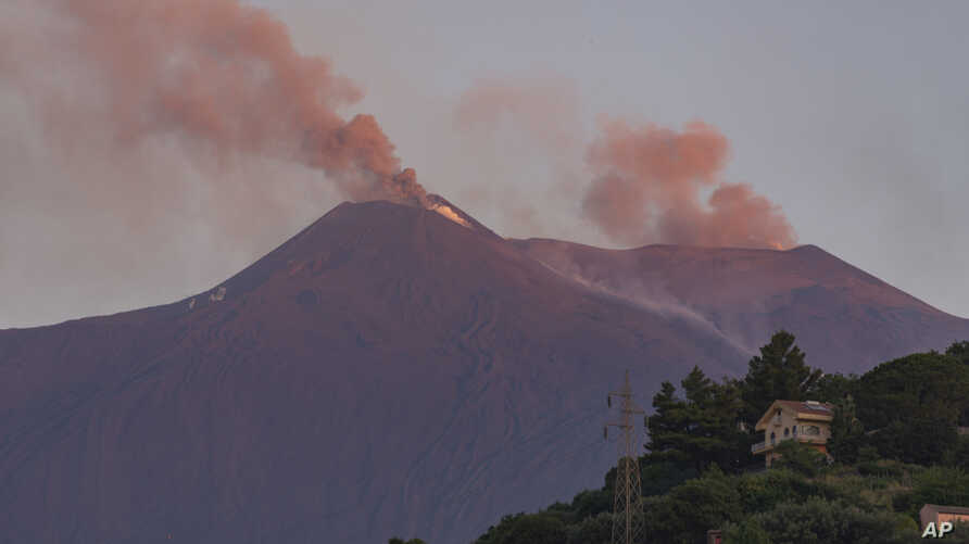 Smoke billows from Mount Etna volcano, the largest of Italy's three active volcanoes, near the Sicilian town of Catania, southern Italy, Saturday, July 20, 2019. (AP Photo/Salvatore Allegra)