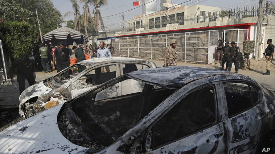 FILE - In this Nov. 23, 2018 file photo, Pakistani security personnel move in the compound of Chinese Consulate following a deadly attack, in Karachi, Pakistan. Aslam Baloch, one of the leaders of the Baluch Liberation Army, blamed for masterminding…