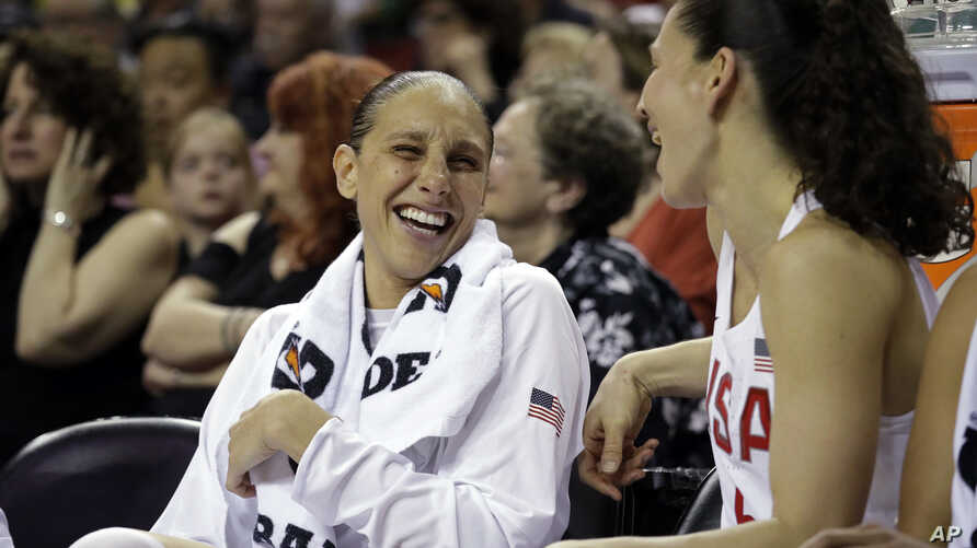 United States' Diana Taurasi, left, shares a laugh with Sue Bird from the bench during an exhibition basketball game against China on Thursday, April 26, 2018, in Seattle. Taurasi admits that she's learning on the fly how to be a parent. The WNBA…