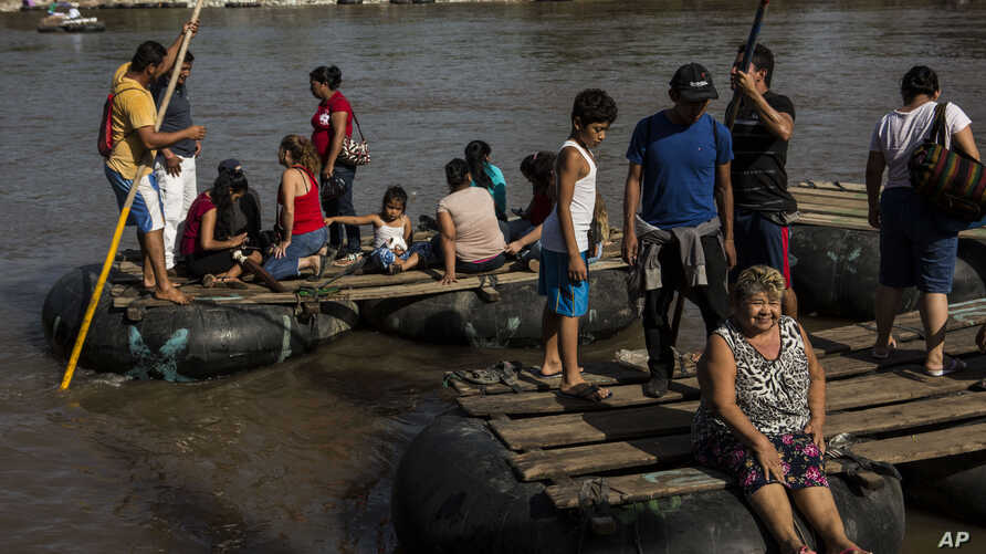"Rafts loaded with passengers leave Tecun Uman, Guatemala, to cross the Suchiate River to reach Mexico, Tuesday, June 25, 2019. Mexico's President Andrés Manuel López Obrador says tightening of immigration controls has focused ""more than anything"" on…"