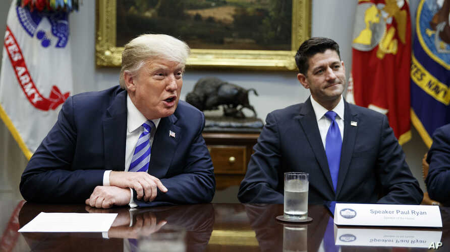 FILE - In this Sept. 5, 2018, file photo, then Speaker of the House Rep. Paul Ryan, R-Wis., listens to President Donald Trump speak during a meeting with Republican lawmakers in the Roosevelt Room of the White House in Washington. Trump unloaded an…