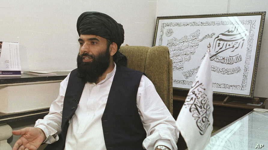 FILE - In this Nov. 14, 2001 file photo, Suhail Shaheen, then Deputy ambassador of the Islamic Republic of Afghanistan, gives an interview in Islamabad, Pakistan. The Taliban spokesman says the seventh and latest round of peace talks with the U.S…