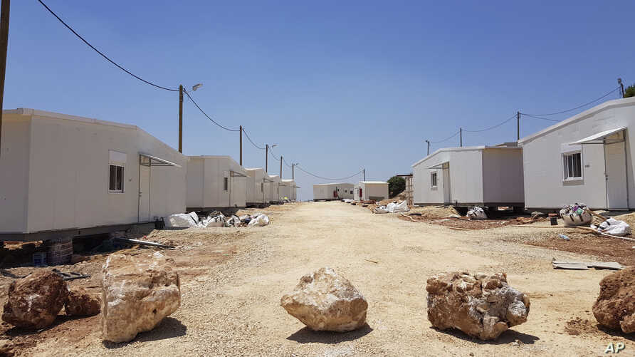 This July 9, 2019, photo shows the general view of a settlement outpost Neve Achi, named by Peace Now as one of the dozens of outposts founded in the West Bank since President Donald Trump entered office.