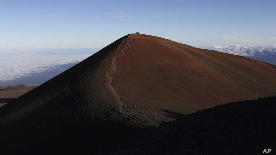 FILE - This July 14, 2019, file photo shows the summit of  Mauna Kea in Hawaii.  Activists say they're protecting Mauna Kea from being the site  of a proposed thirty meter telescope.