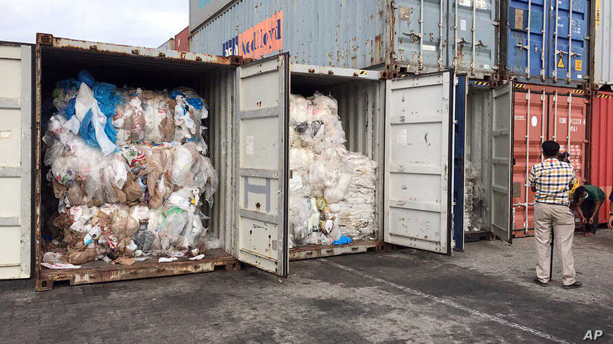 In this Tuesday, July 16, 2019, photo, containers loaded with plastic waste are placed at country beach city, Sihanoukville Port, southwest of Phnom Penh, Cambodia. A Cambodia's committee to investigate the sources of the trash discovered packing in…