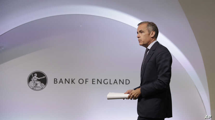 Mark Carney the Governor of the Bank of England arrives at the start of a Financial Stability Report press conference at the Bank of England in the City of London, Thursday, July 11, 2019. (AP Photo/Matt Dunham, Pool)