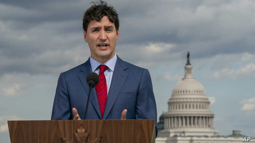 Canadian Prime Minister Justin Trudeau speaks to reporters from the roof of the Canadian Embassy in Washington after a day of meetings on a replacement for the North American Free Trade Agreement,  June 20, 2019.