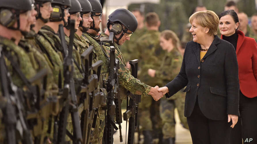 German chancellor Angela Merkel shakes hands with soldiers during a visit of the German Army medical service in Leer, northern Germany, Monday, Dec. 7, 2015. Germany's parliament voted last week to send military support in the fight against Islamic…