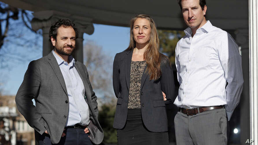 FILE - In this Dec. 20, 2018 file photo attorneys, from left, David Seligman, Nina DiSalvo and Alexander Hood, of Towards Justice, pose outside the organization's office east of downtown Denver. Low paid childcare workers from around the world could…