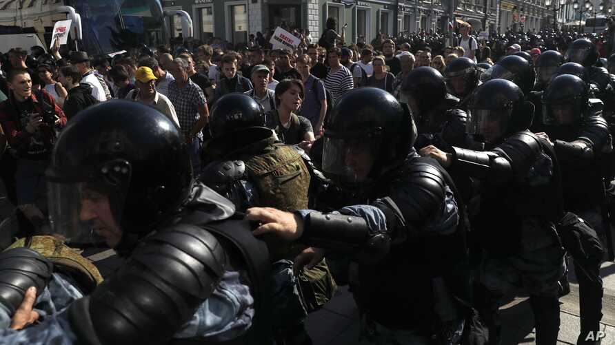 Police block a street during an unsanctioned rally in the center of Moscow, Russia, Saturday, July 27, 2019. Russian police clashed with demonstrators and have arrested some hundreds in central Moscow during a protest demanding that opposition…