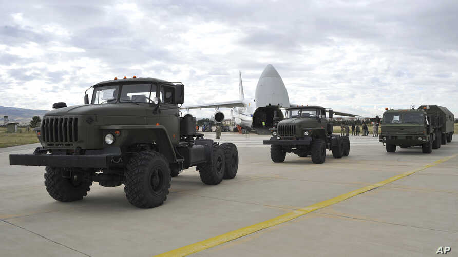 Military vehicles and equipment, parts of the S-400 air defense systems, are seen on the tarmac, after they were unloaded from a Russian transport aircraft, at Murted military airport in Ankara, July 12, 2019.
