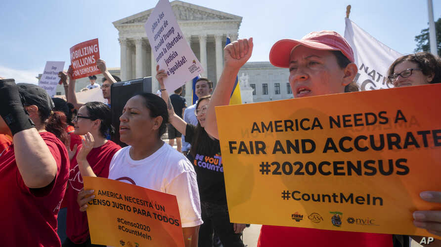 Demonstrators gather at the Supreme Court as the justices finish the term with decisions on gerrymandering and a census case involving a bid by the Trump administration to ask everyone about their citizenship status in the 2020 census, July 27, 2019.
