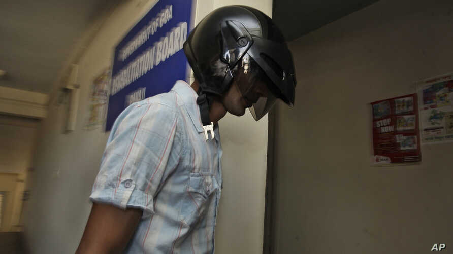 Samson D'Souza, face covered with a helmet arrives at the Goa State Children's Court in Panaji, India, Monday, April 5, 2010. D'Souza, is facing charges of culpable homicide, sexual assault and destroying evidence in the 2008 death of a British…