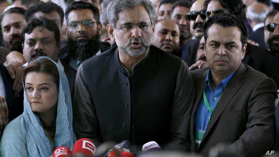 Shahid Khaqan Abbasi, center, speaks to reporters  following a supreme court decision in Islamabad, Pakistan,  March 26, 2019.
