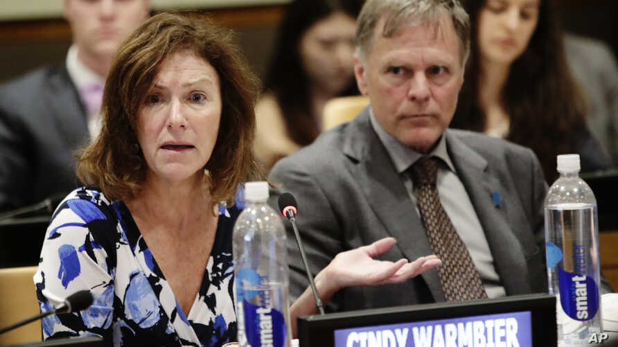 FILE- In this May 3, 2018 file photo, Fred Warmbier, right, listens as his wife Cindy Warmbier, speaks of their son Otto Warmbier, an American who died in 2017 days after his release from captivity in North Korea, during a meeting at the United…