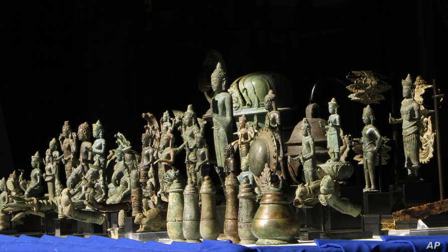 Eighty-five artifacts are displayed before the handover ceremony at the National Museum, in Phnom Penh, Cambodia, July 5, 2019. The collector says she is glad she returned the artifacts.