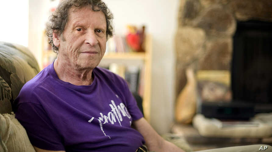 FILE - In this May 7, 2009, file photo, author, comedian and co-founder of the Yippie party as well as stand-up satirist, Paul Krassner, 77, poses for a photo at his home in Desert Hot Springs, Calif. Krassner, the publisher, author and radical…