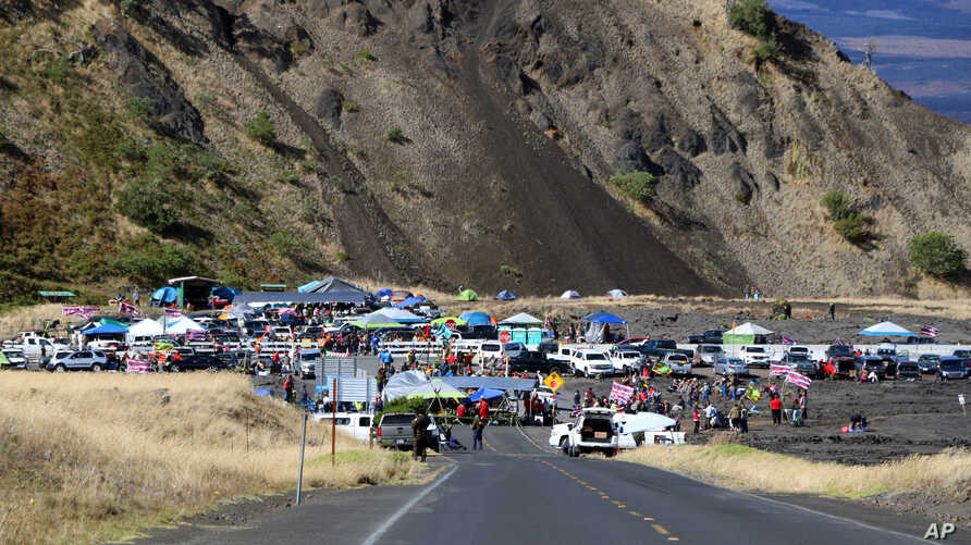 People who are against the construction of a Hawaii telescope continuing to block the roadway to the top of Mauna Kea, a mountain considered sacred by some Native Hawaiians, July 18, 2019.