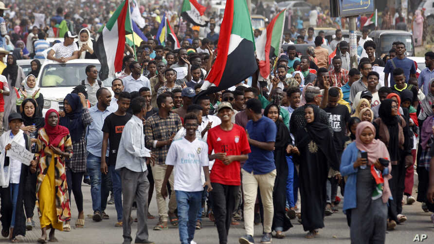 Sudanese protesters march during a demonstration in the capital Khartoum, Sudan, Aug. 1, 2019. The Sudanese Professionals Association said Thursday that the rallies are demanding justice for the killing of at least six people earlier this week.