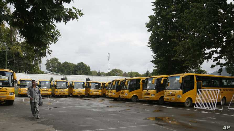 School buses are parked inside the premises of a deserted school compound in Srinagar, Indian controlled Kashmir, Monday, Aug. 19, 2019. Restrictions continue in much of Indian-administered Kashmir, despite India's government saying it was gradually…