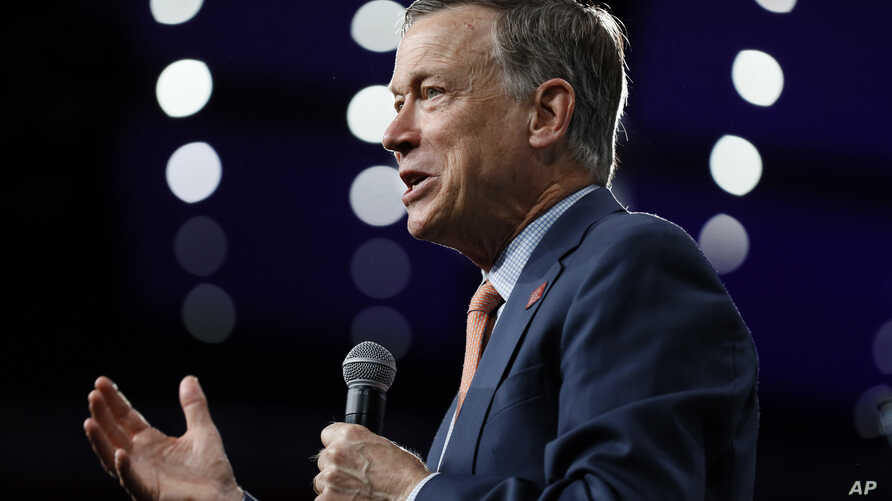 Democratic presidential candidate former Colorado Gov. John Hickenlooper speaks at the Presidential Gun Sense Forum, Aug. 10, 2019, in Des Moines, Iowa.
