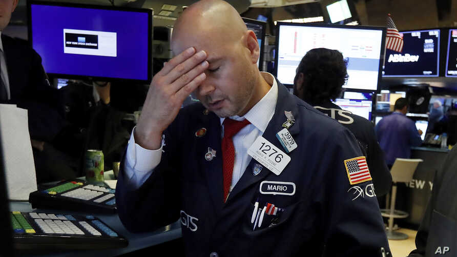 Specialist Mario Picone works on the floor of the New York Stock Exchange, Wednesday, Aug. 14, 2019. The Dow Jones Industrial Average sank 800 points after the bond market flashed a warning sign about a possible recession for the first time since…