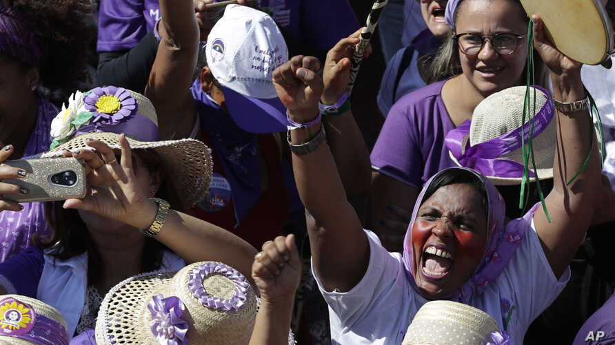 Women participate in the Margaridas march, in front of the Brazilian National Congress, in Brasilia, Brazil, Wednesday, Aug. 14, 2019. The Margaridas, or Daisies, formed to honor Margarida Maria Alves, a murdered local leader of the Rural Worker's…