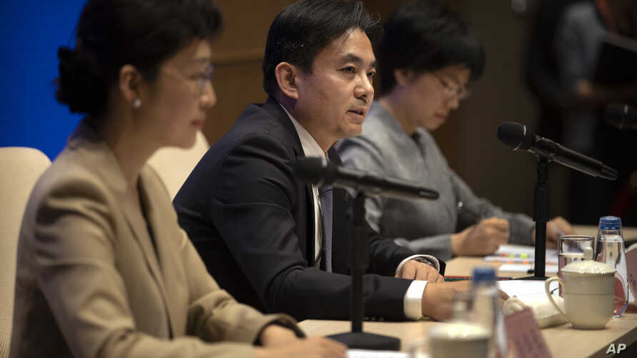 Yang Guang, center, spokesman for the Chinese Cabinet's Hong Kong and Macao Affairs Office, speaks during a press conference in Beijing, Tuesday, Aug. 6, 2019. A Chinese official responsible for Hong Kong affairs says punishment for those behind…