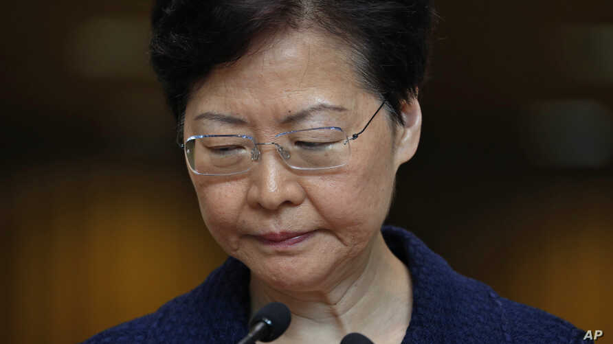 "Hong Kong Chief Executive Carrie Lam pauses during a press conference in Hong Kong Tuesday, Aug. 20, 2019. Lam said she's setting up a ""communication platform"" to resolve differences in the Chinese city, which has been wracked by months of chaotic…"