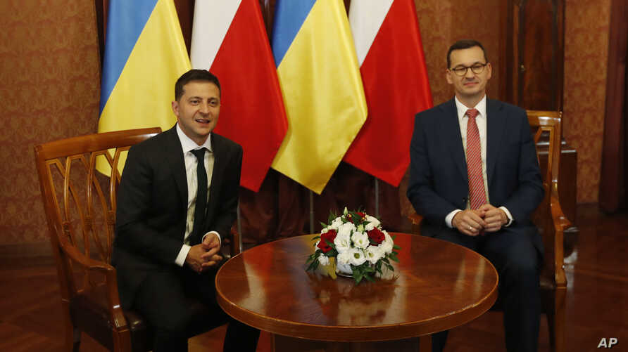 Poland's Prime Minister Mateusz Morawiecki, right, welcomes Ukraine's President Volodymyr Zelenskiy as they meet in Warsaw, Poland, Saturday, Aug. 31, 2019. Zelenskiy is in Warsaw with members of his new Cabinet and will attend ceremonies marking 80…