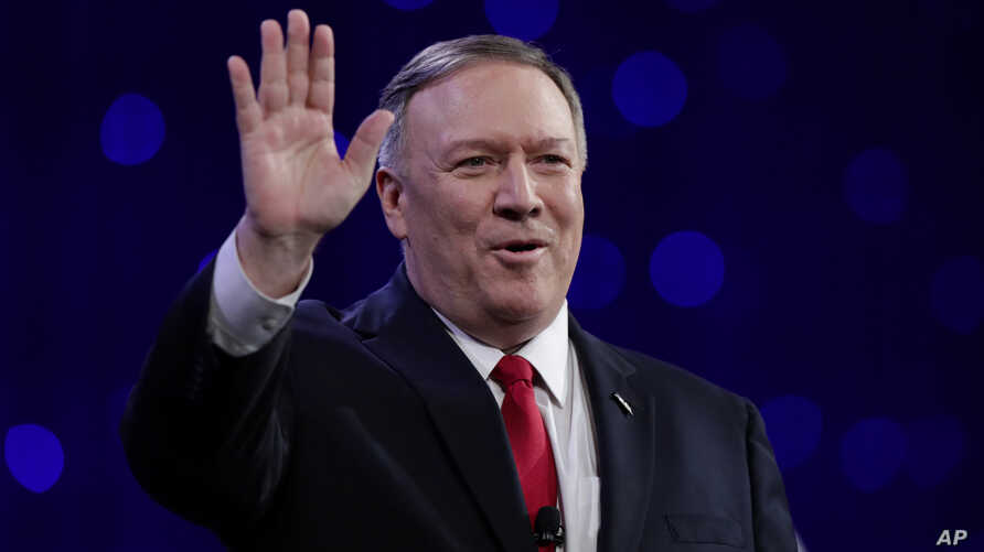 Secretary of State Mike Pompeo waves the crowd before speaking at the 101st National Convention of The American Legion in Indianapolis, Tuesday, Aug. 27, 2019. (AP Photo/Michael Conroy)