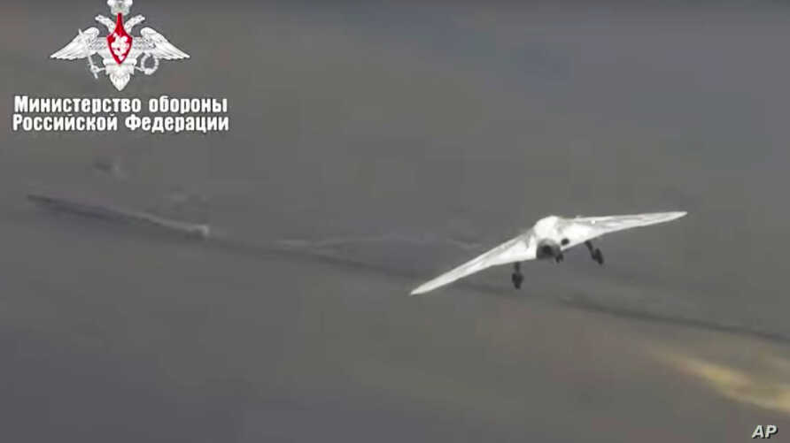 In this video grab made available on Wednesday, Aug. 7, 2019 by Russian Defense Ministry Press Service, Russia's military drone Okhotnik is seen in flight at an unidentified location in Russia. The ministry said the drone, which has stealth…