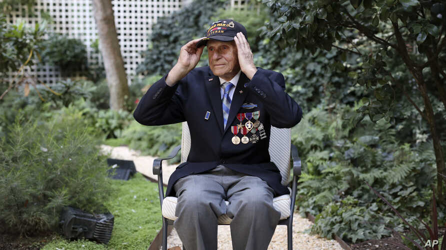 Steven Melnikoff, 99, of the 175th regiment of the 29th infantry division and is one of the few veterans left who took part to the D-Day landings on June 06, 1944, adjusts his cap during an interview with the Associated Press Friday, Aug.23, 2019 in…