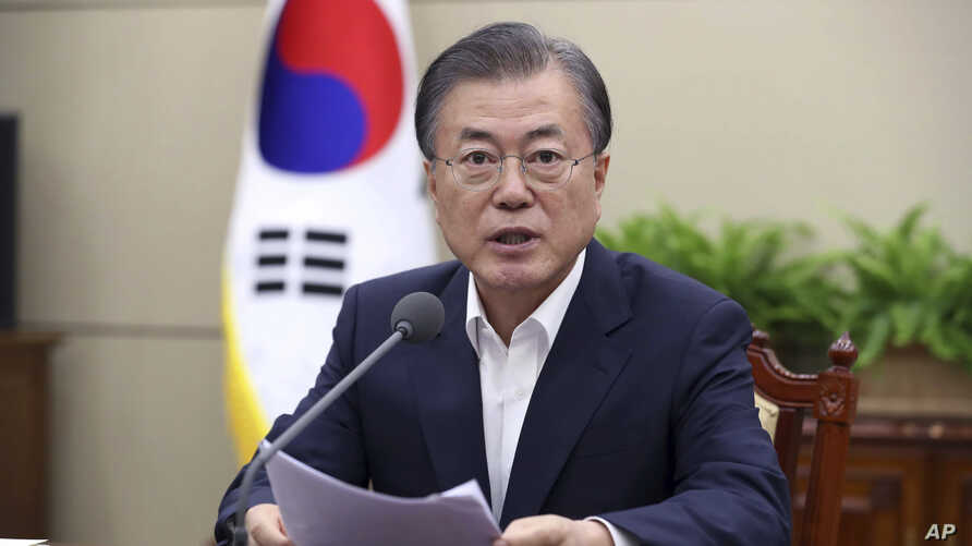 South Korean President Moon Jae-in speaks during a meeting with his senior aides at the presidential Blue House in Seoul, South Korea, Monday, Aug. 5, 2019. Moon on Monday described the country's escalating trade war with Japan as a wake-up call to…